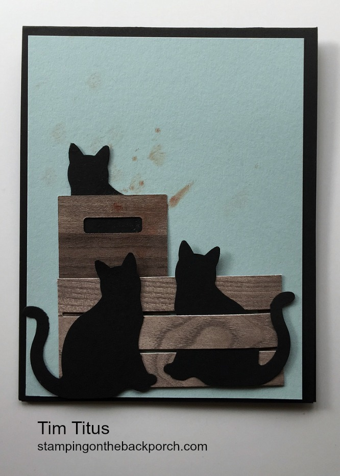 cats on crates made by Tim who added the blood from stabbing his finger with the scissors - an oops card